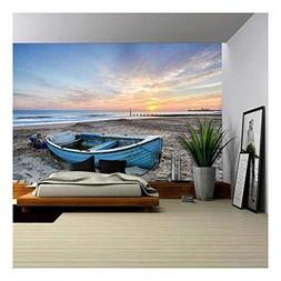 wall26 - Turquoise Blue Fishing Boat at Sunrise on Bournemou